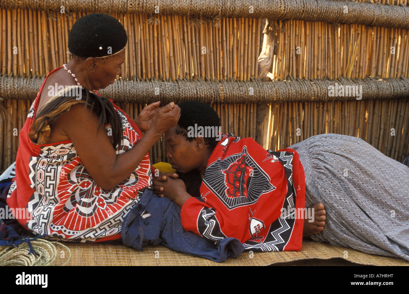 Swazi women platting hair Mantenga village Swaziland Stock Photo