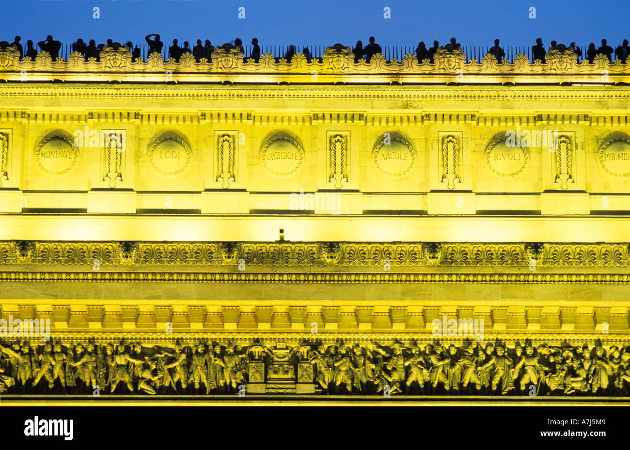 Arc de triomphe, Paris illuminated in the evening - Stock Image