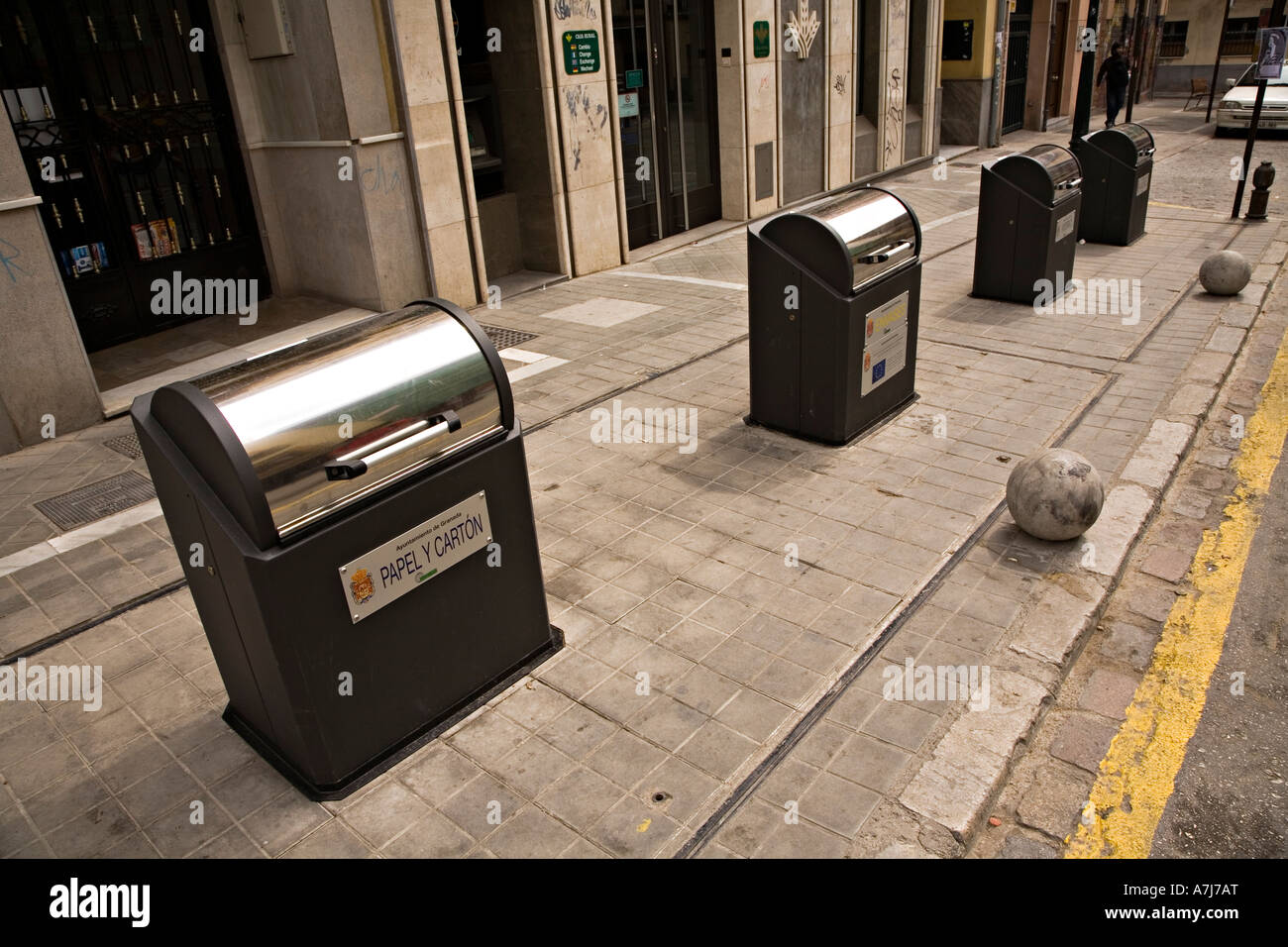 Modern recycling bins in street where rubbish drops into underground