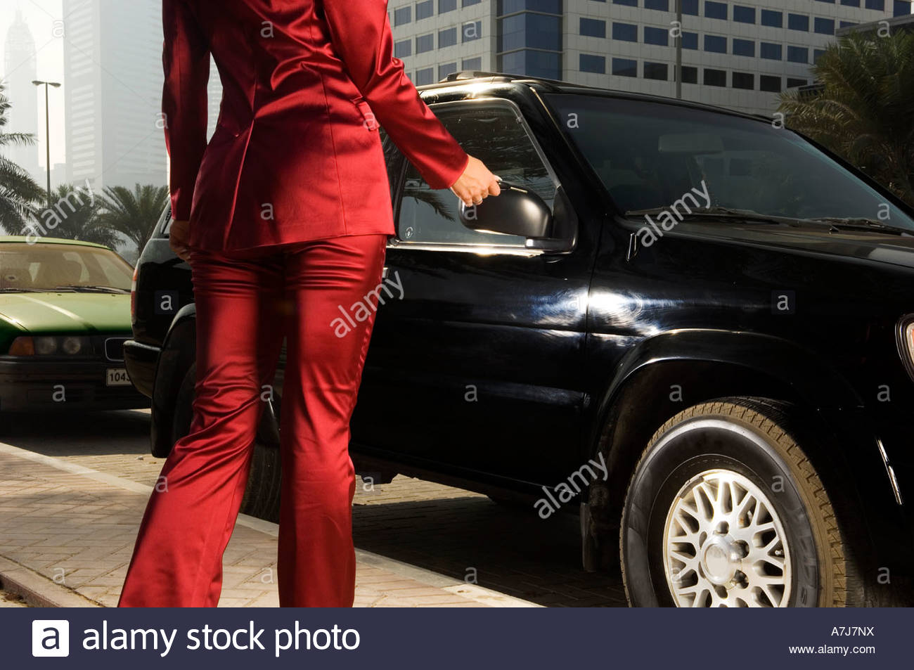 A businesswoman parking her car - Stock Image