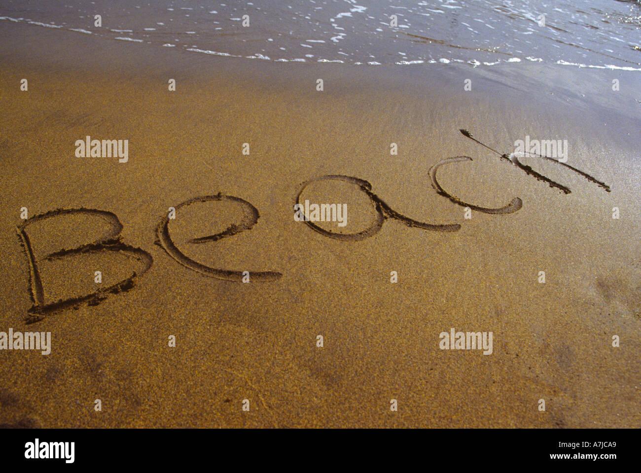 Beach written in sand Spain - Stock Image