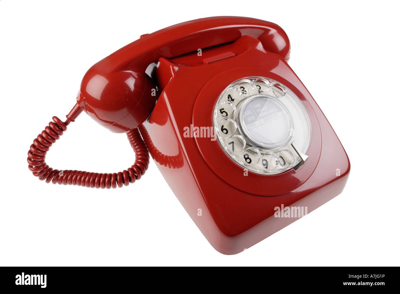 Red old fashioned disc dialling phone - Stock Image