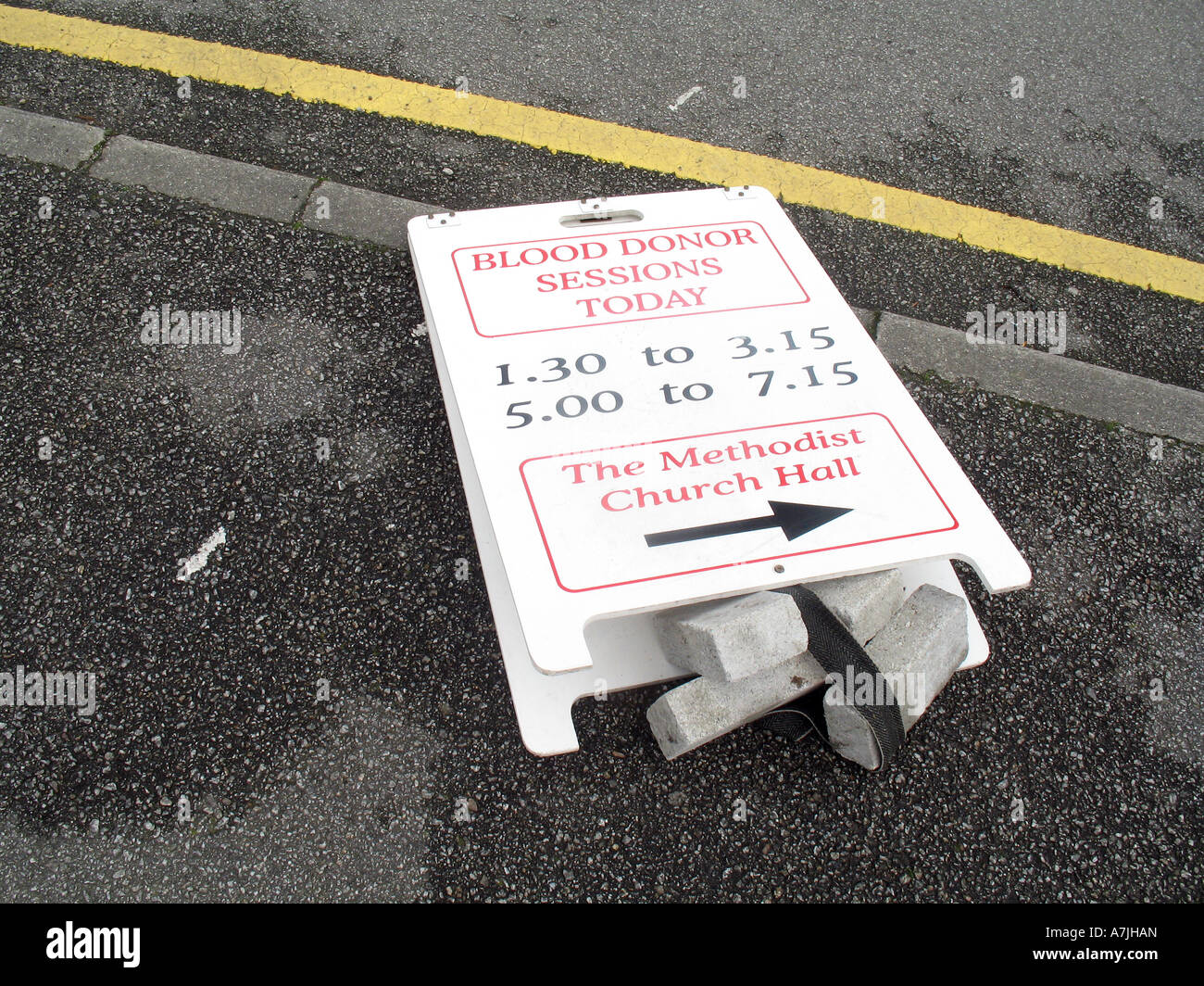Blood donor session sign lying in road Cornwall UK - Stock Image