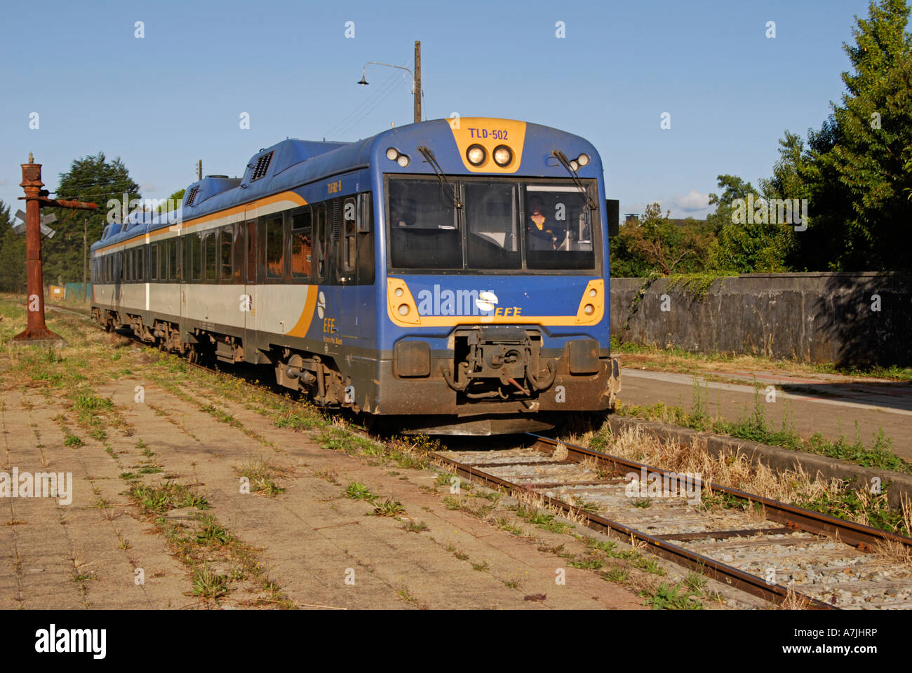 Diesel multiple unit approaching Puerto Varas station Chile with a train bound for Puert Montt. - Stock Image