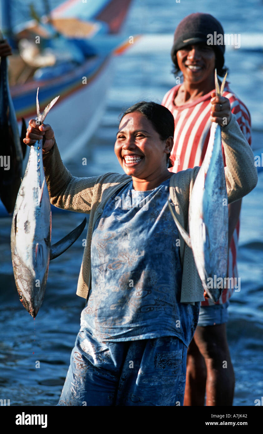 Elated expression on the face of a Balinese fisherman s wife holding a successful catch Pemuteran Bali s N coast Stock Photo