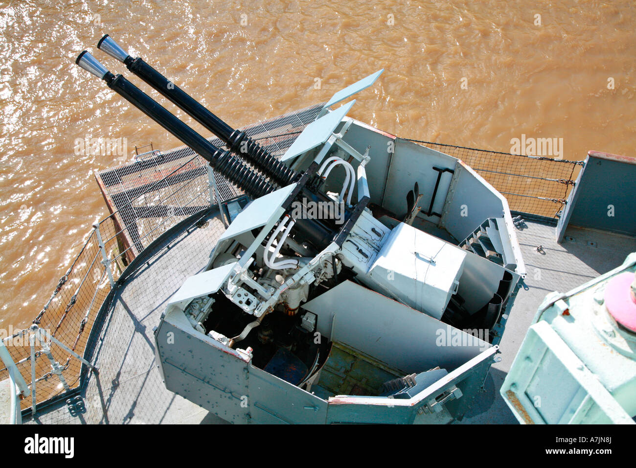 Anti aircraft guns on board the HMS Belfast on the Thames in London - Stock Image