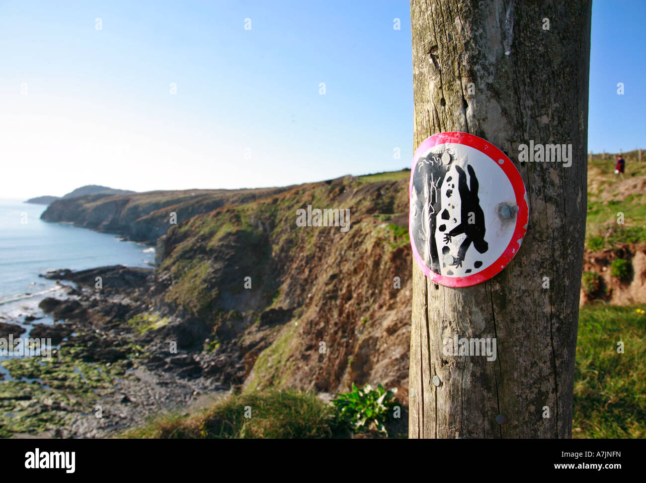 Beware steep cliffs warning sign on the North Pembrokeshire coastal footpath national trail - Stock Image