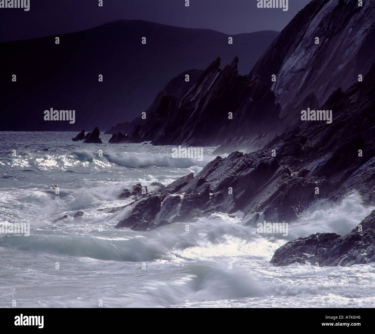 Dunmore Head, Dingle Peninsula, County Kerry, Ireland.  Storm waves and sunburst - Stock Image