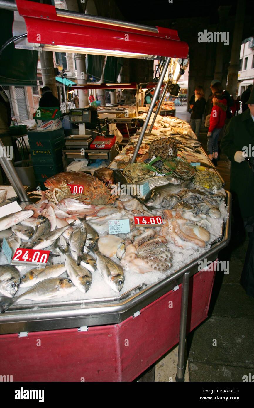 Famous Venice fish Market Prescaria near Rialto bridge and Grand Canal sells fresh local fish Italy Europe EU Stock Photo