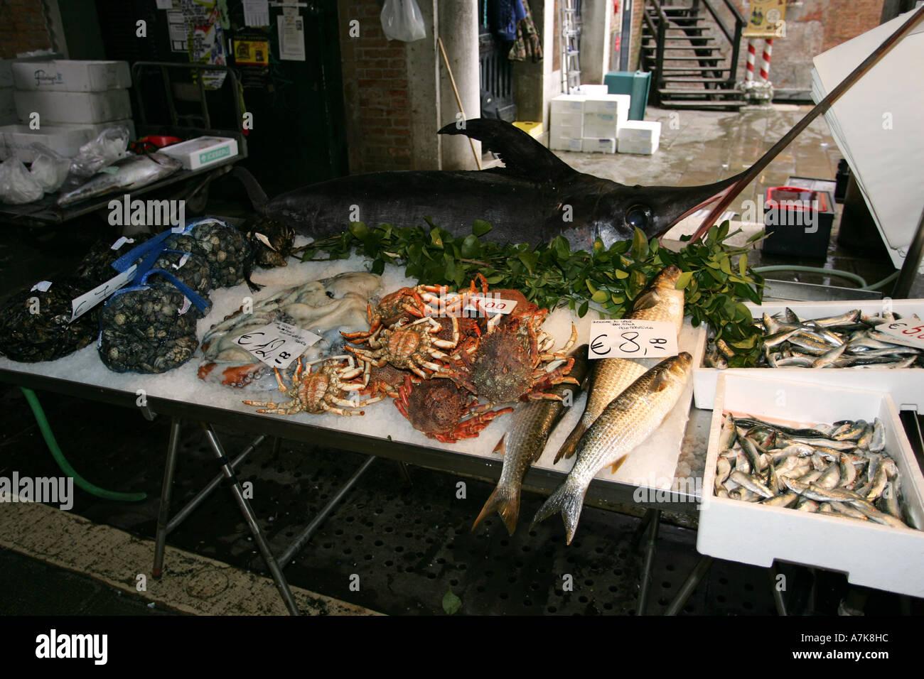 World famous fish market Prescaria near the Rialto Bridge, central Venice Italy Europe popular with tourists Stock Photo