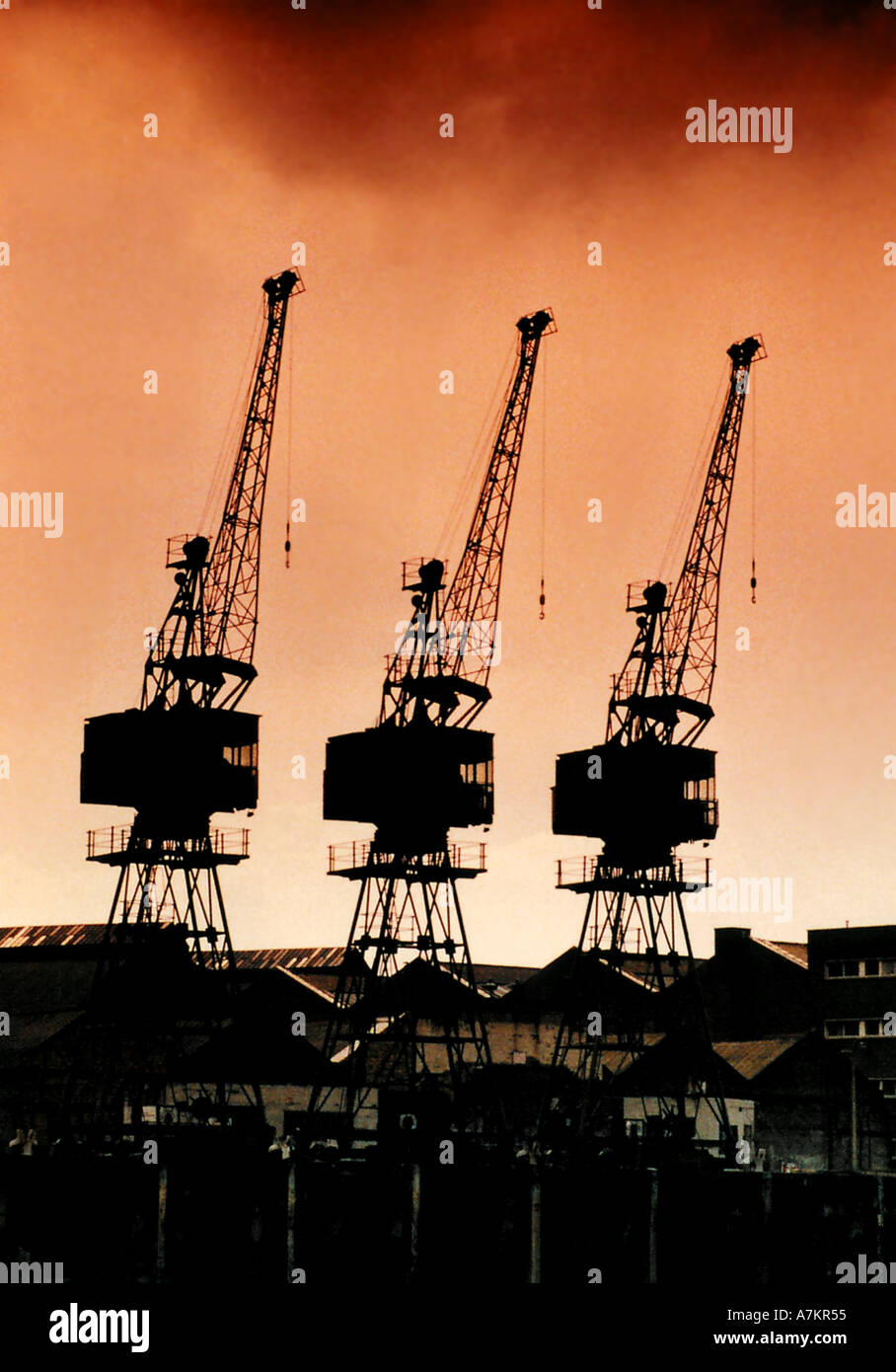 Silhouette of cranes in Docklands London - Stock Image