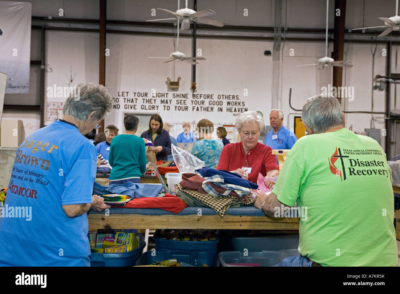 Volunteers Pack Supplies for Disaster Relief - Stock Image