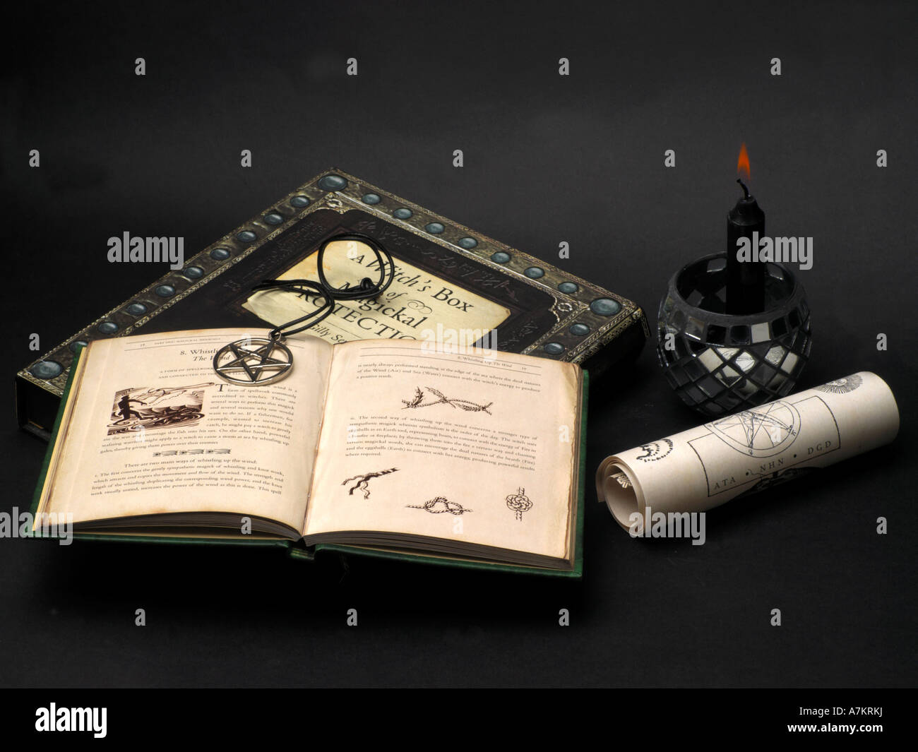 Witches Protection, Scroll, Candle, Pentacle & Spell Book - Stock Image