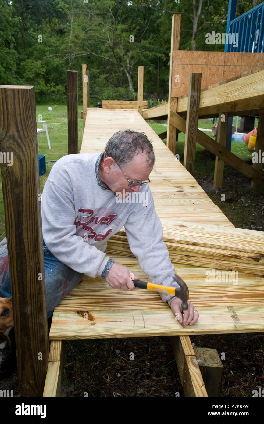 volunteers build wheelchair ramp stock photo: 11865216 - alamy