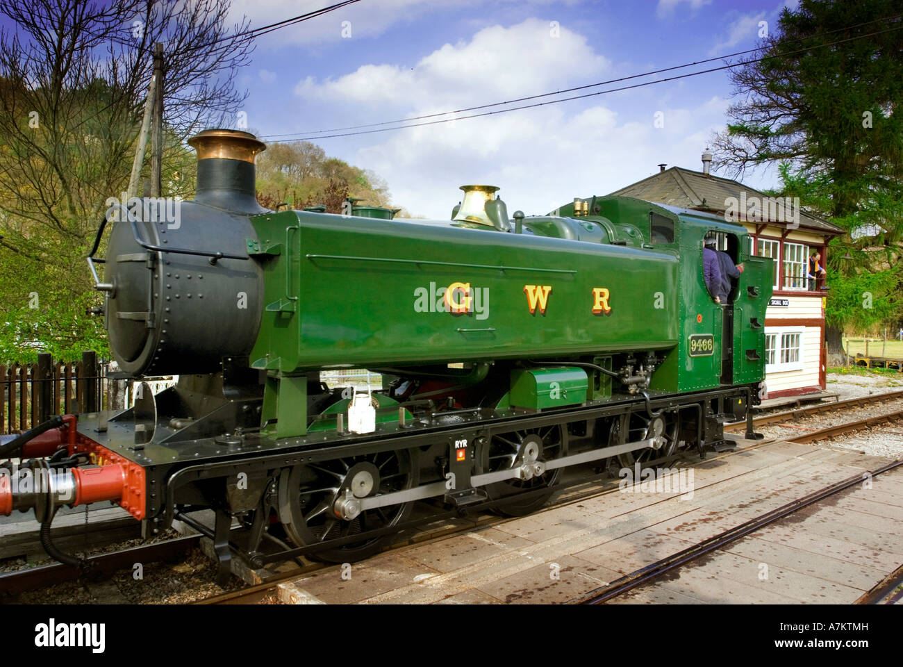 A steam tank engine pictured station on the Llangollen heritage railway with passenger coaches at Glyndyfrdwy Station. Stock Photo