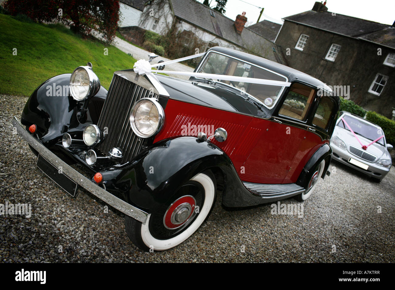 Red And Black Vintage Rolls Royce Wedding Car With Typical White
