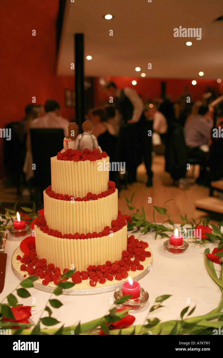 Three Tiered Modern Wedding Cake Decorated With White Chocolate