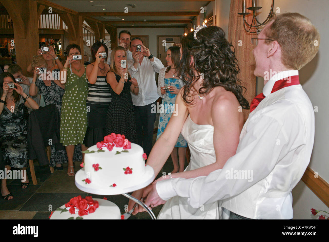 when to cut the wedding cake tradition a newly wed and groom cut their traditional wedding 27123