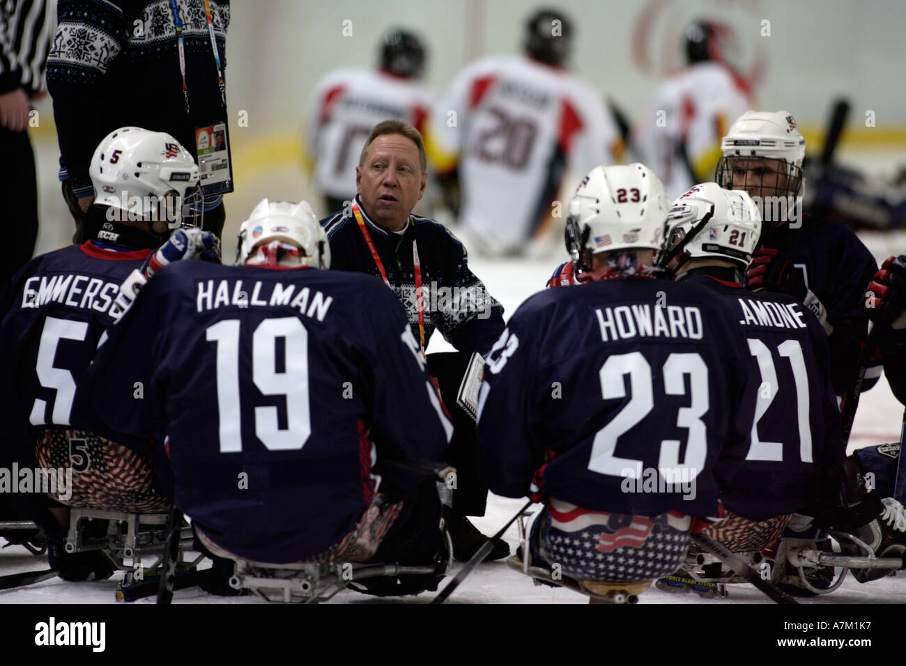 Team USA coach gives his team a pep talk during the opening game Stock Photo
