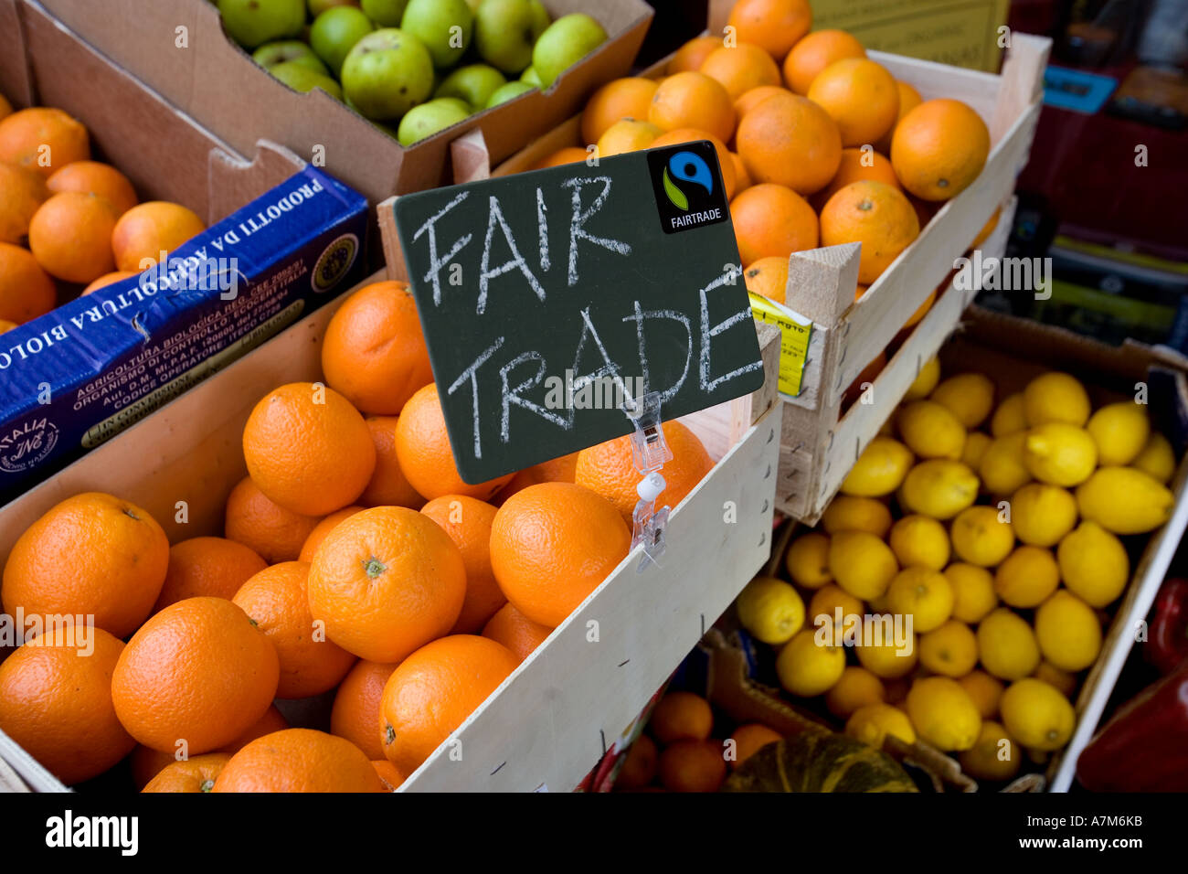 Fair trade fruit on sale outside an organic shop in Oswestry, Shropshire, UK - Stock Image
