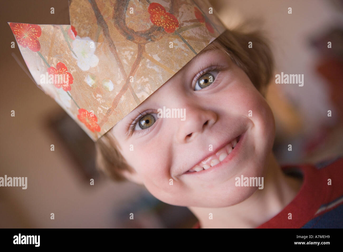 1d77dc0badf57 Young boy wearing paper crown Stock Photo  6783640 - Alamy
