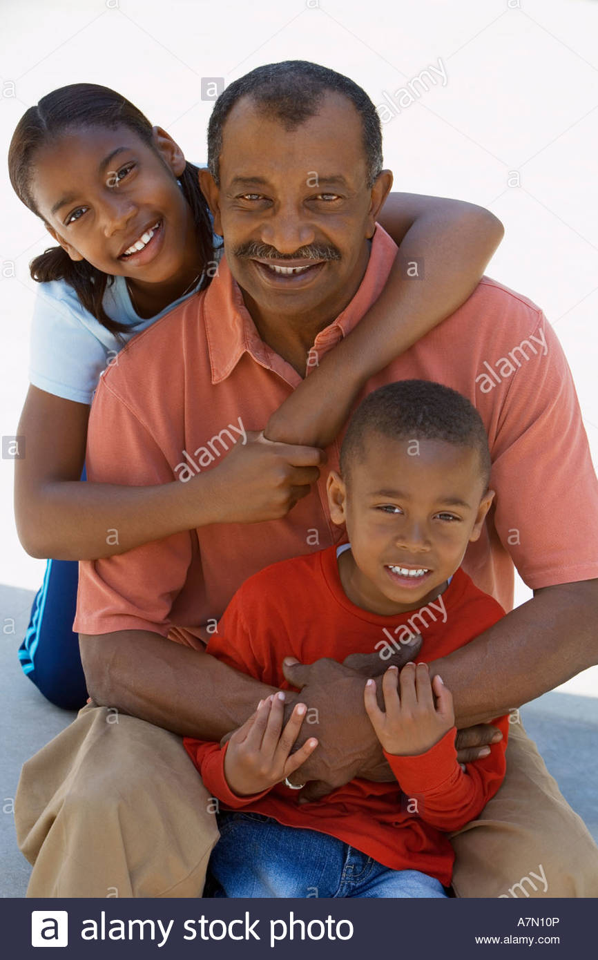 Grandfather and grandchildren 6 13 smiling front view portrait - Stock Image