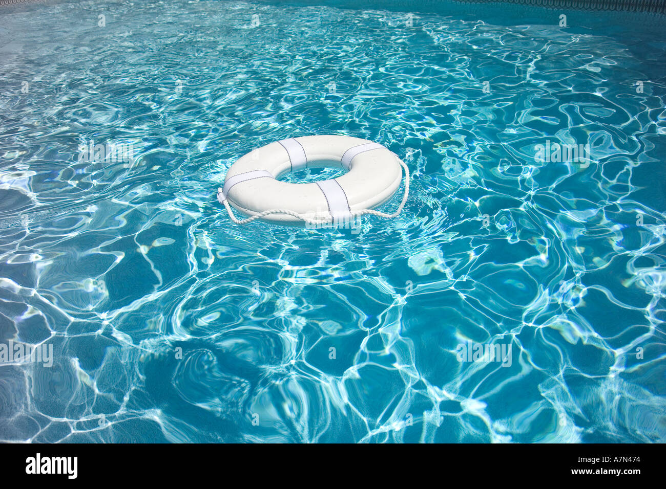 Life Preserver in pool life jacket - Stock Image