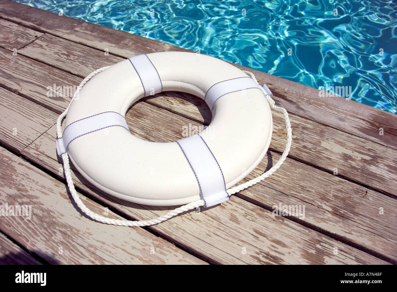 Life preserver on pool deck life jacket - Stock Image
