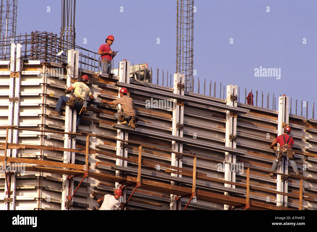 e769670c683c3 Construction workers work with rebar on a new concrete building ...
