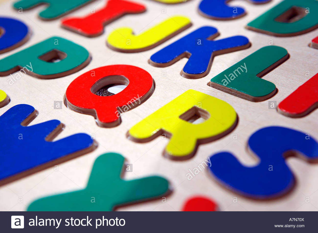 Multi coloured capital letters of the alphabet close up full frame still life - Stock Image