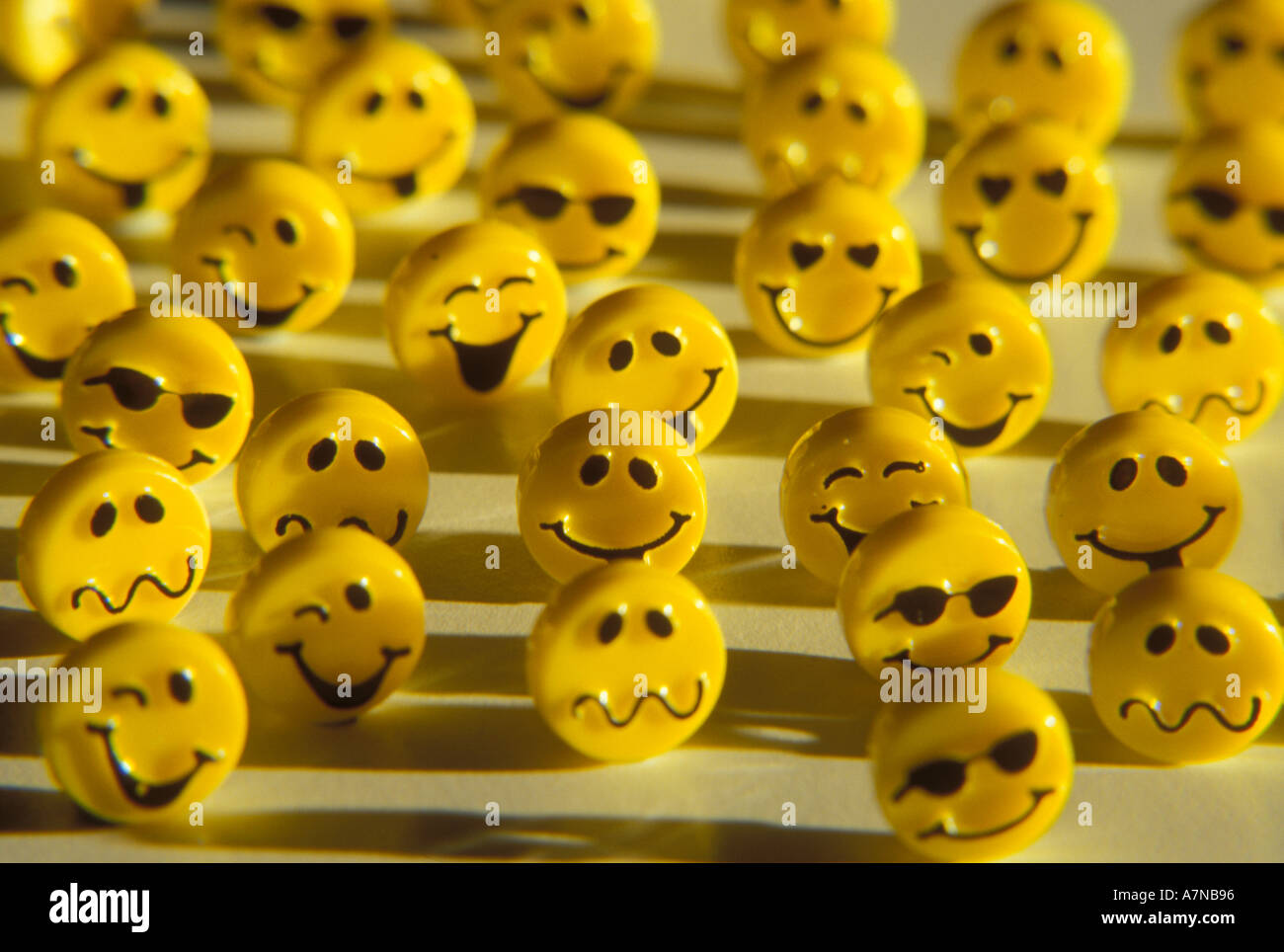 Still life of a group of yellow happy faces with various expressions Stock Photo