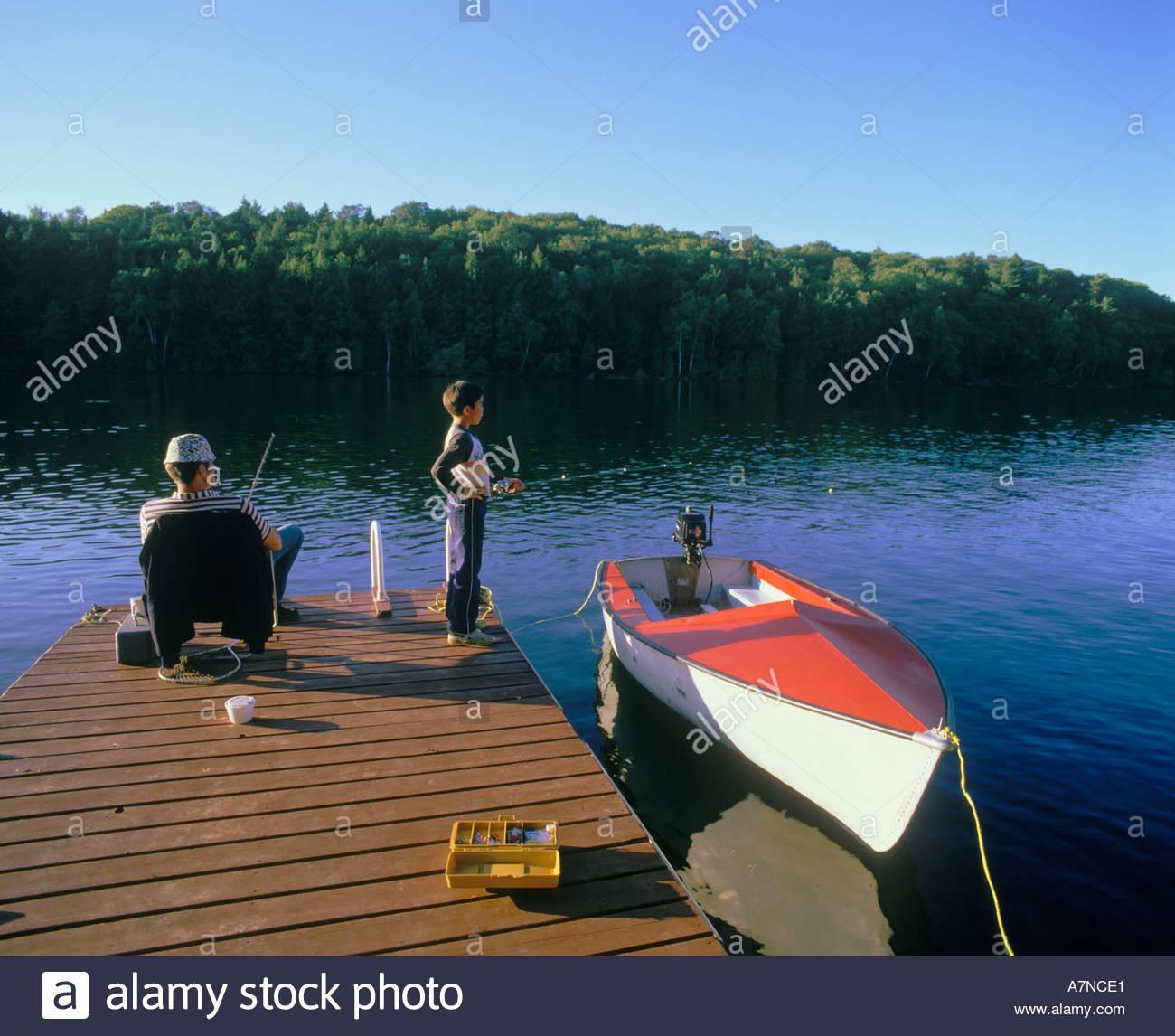 Fishing from cottage dock at Long Lake Haliburton Ontario