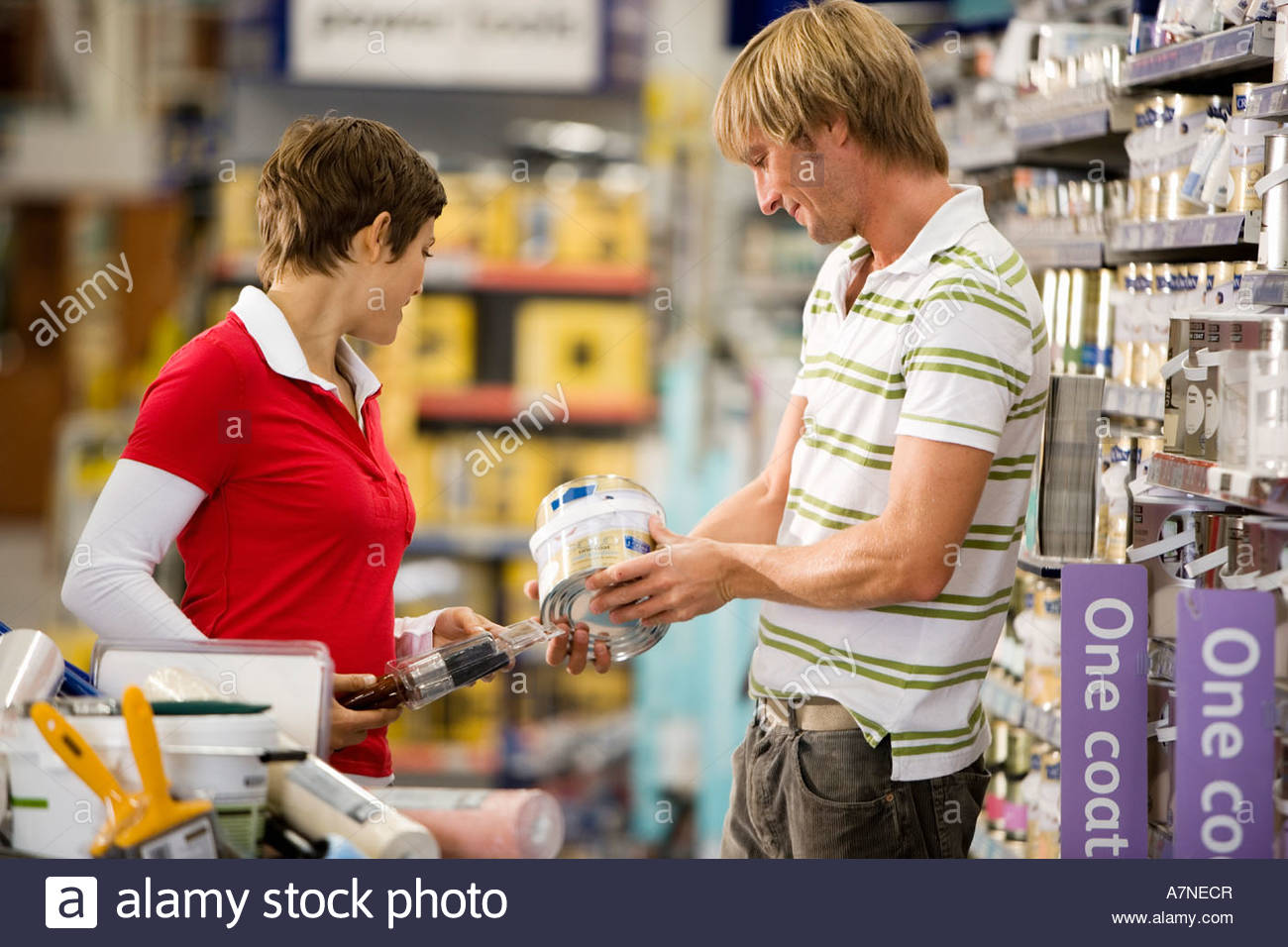Do it yourself shop stock photos do it yourself shop stock images couple shopping in diy shop man choosing tin of paint side view stock image solutioingenieria Gallery