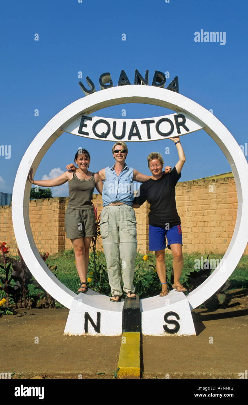 Tourists crossing the Equator, Uganda - Stock Image