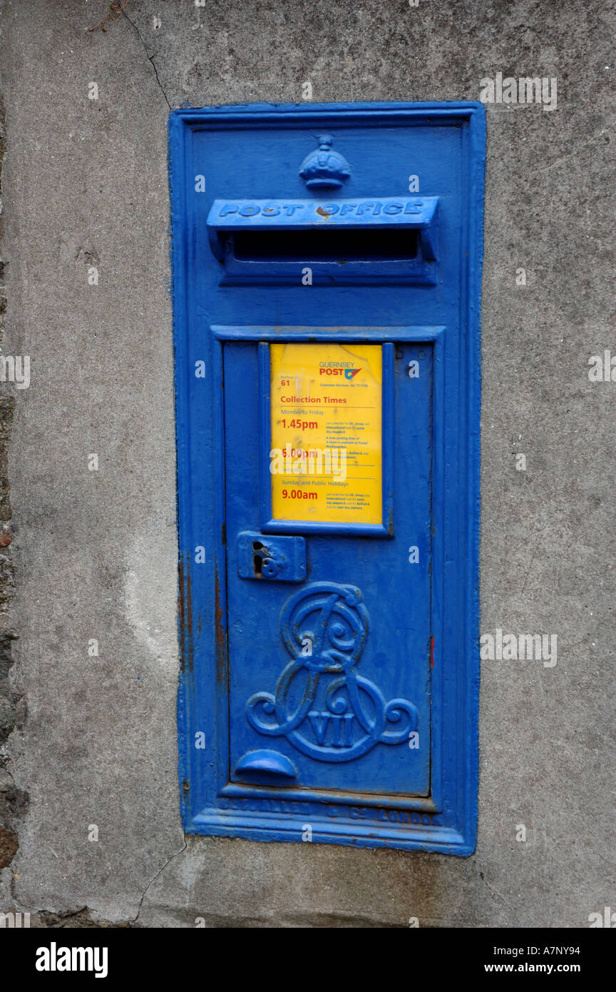 Blue post box in a wall in St Peter Port in Guernsey, Channel