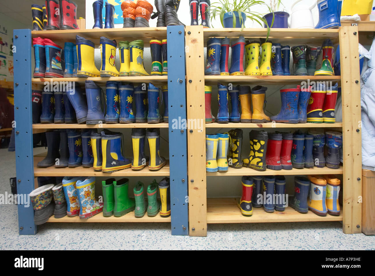 DEU, Germany, shoerack in a day-care centre center for children - Stock Image