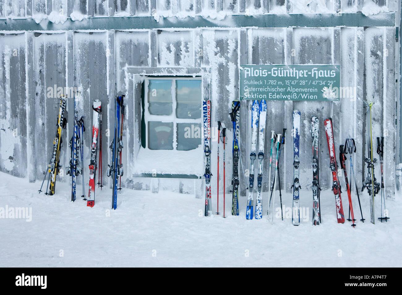 Ski lean on the wall of the Alois Günther mountain hut on top of the mountain Stuhleck Styria Austria - Stock Image