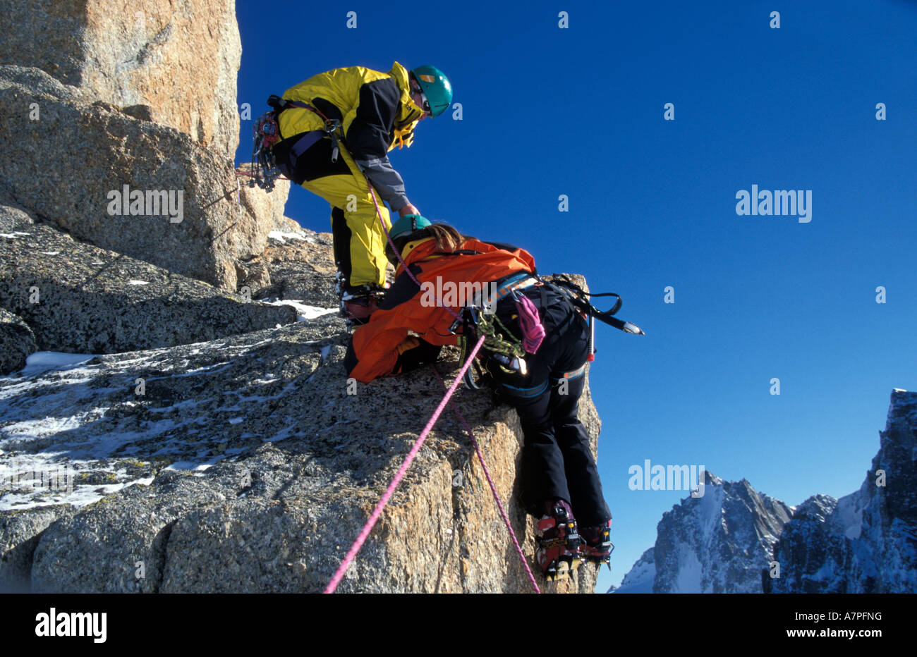 Richard Mansfield and Vaila Macdonald climbing high in the mountains near Chamonix French Alps - Stock Image