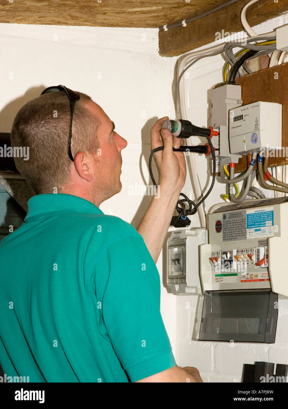 an electrician testing checking for live wires when installing a rh alamy com Home Electrical Wiring Diagrams Home Electrical Wiring Diagrams
