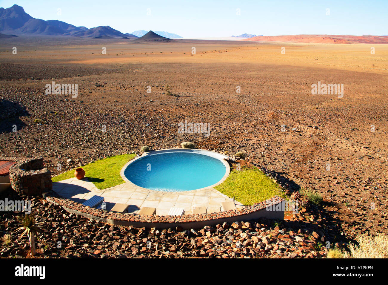 A circular swimming pool in an exclusive lodge located in a vast desert plain Namibrand Nature Reserve Namibia - Stock Image