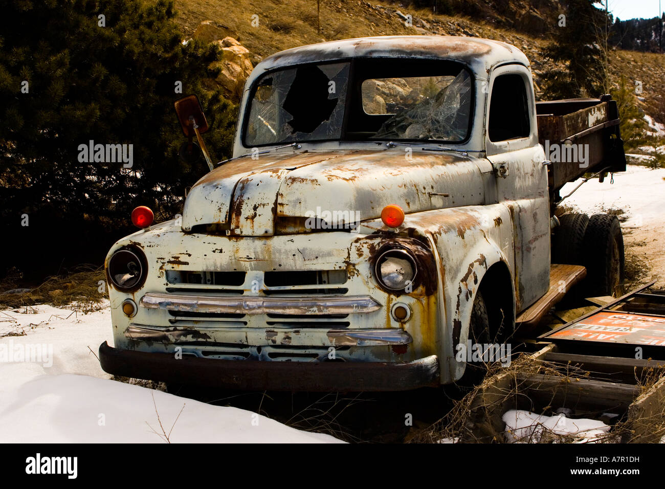 Rusty old car in open air in Colorado USA in snow and ice. Broken ...