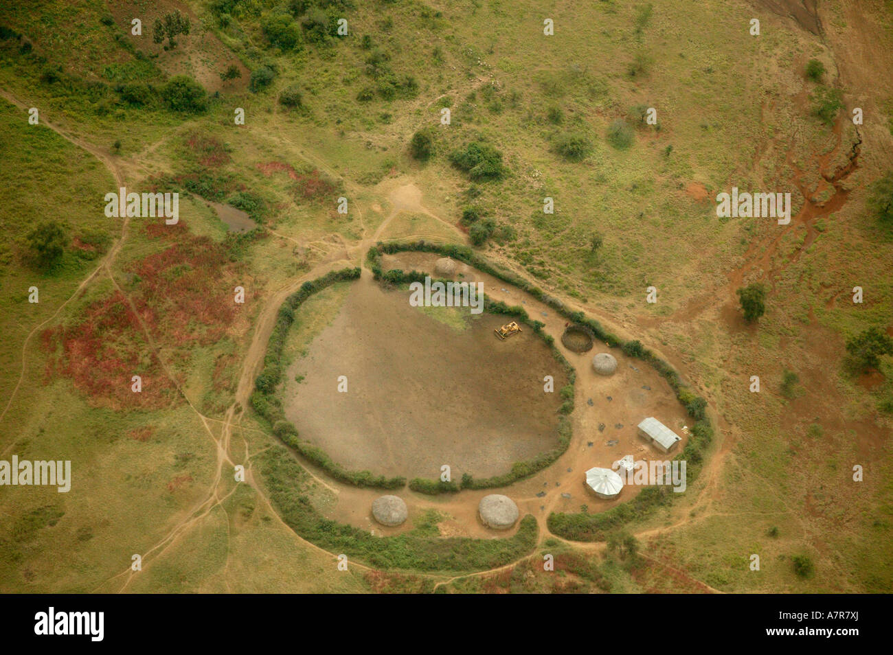 An aerial view of a rural Masaai homestead built around a cattle and goat kraal and showing a network of paths - Stock Image