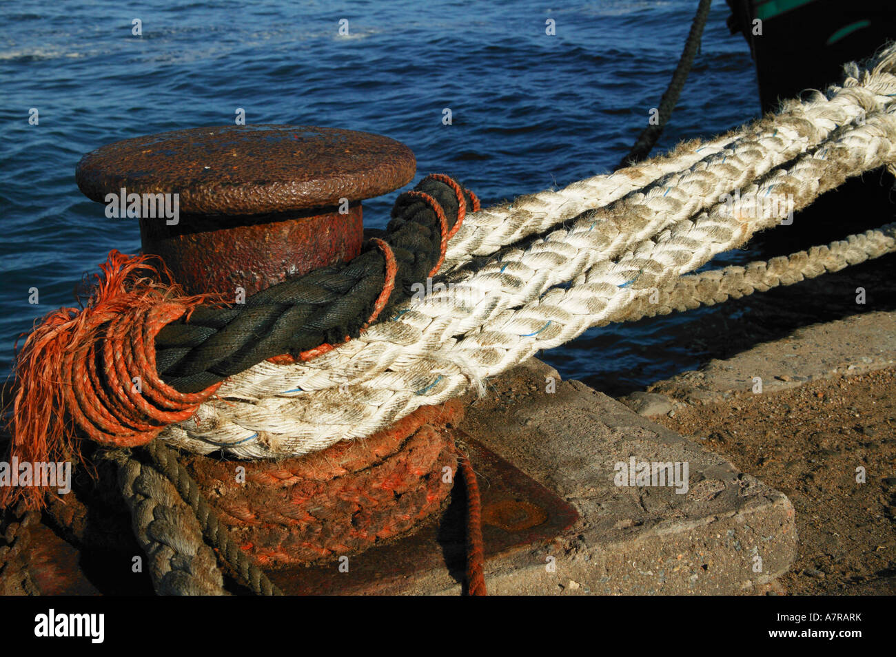 A bollard with ropes tied around it Port Nolloth Northern Cape South Africa - Stock Image