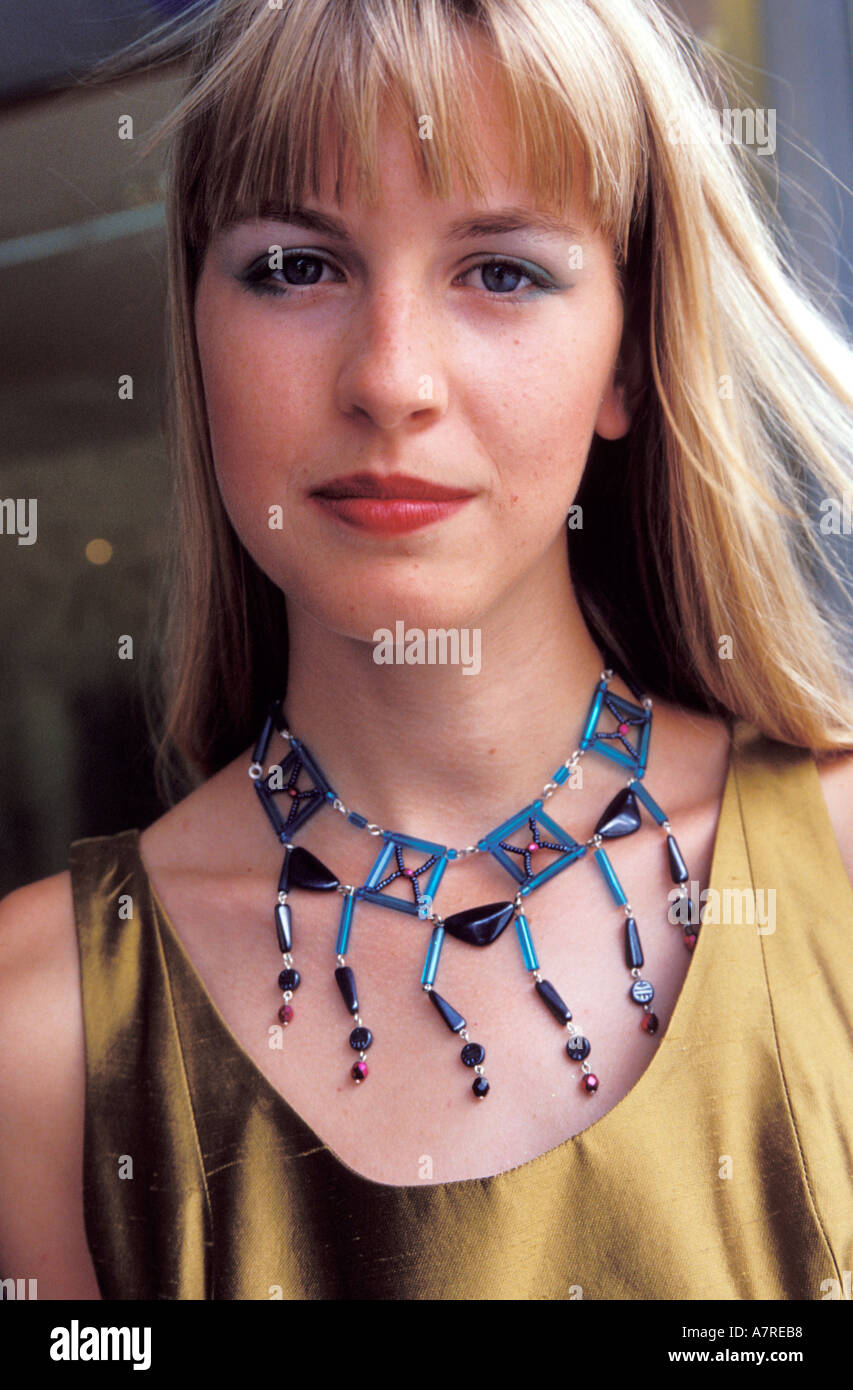 Young Woman Wearing Beaded Necklace - Stock Image