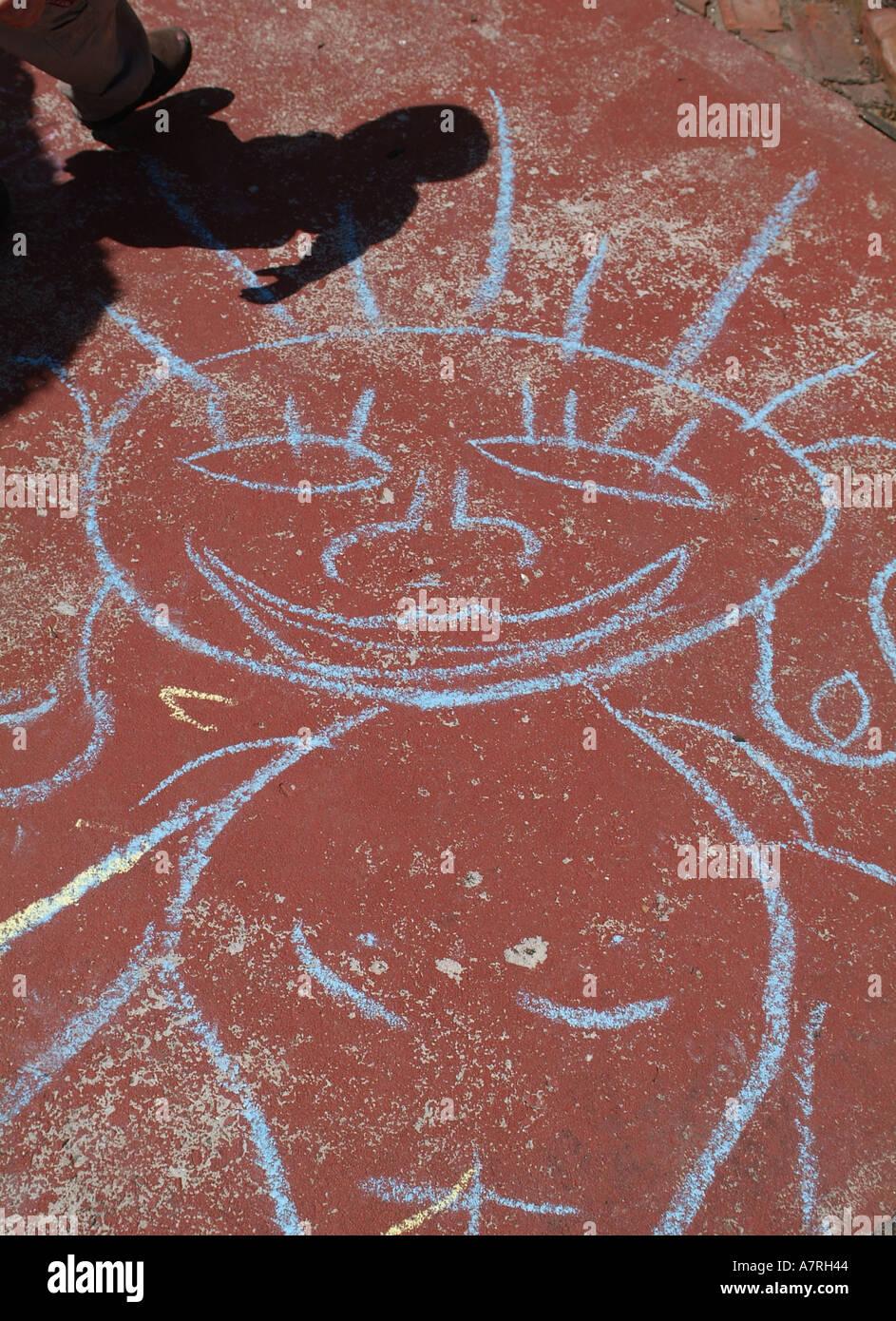 Odd street art chalk drawing figure with shadow - Stock Image