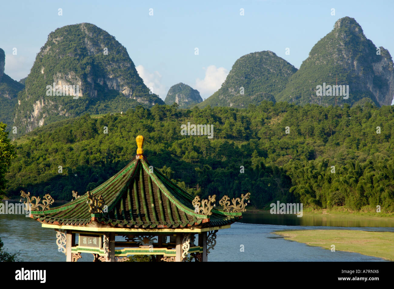 China, Guangxi, Yangshuo County - a typical Chinese pavilion on the Li River in the evening Stock Photo