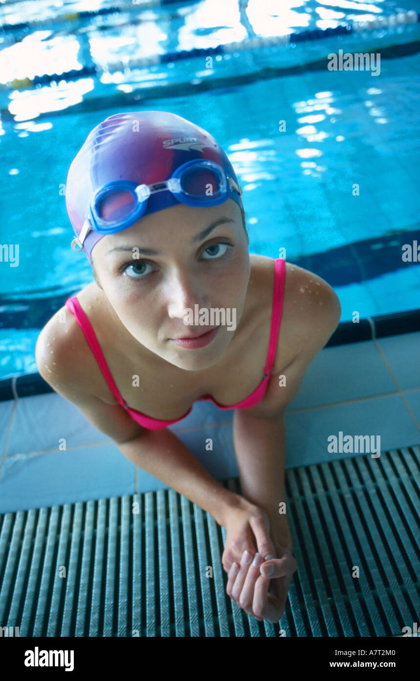 86e7b19f53fee indoor swimming pool water close up woman girl 20 25 young bathing cap  spectacles swim swimsuit