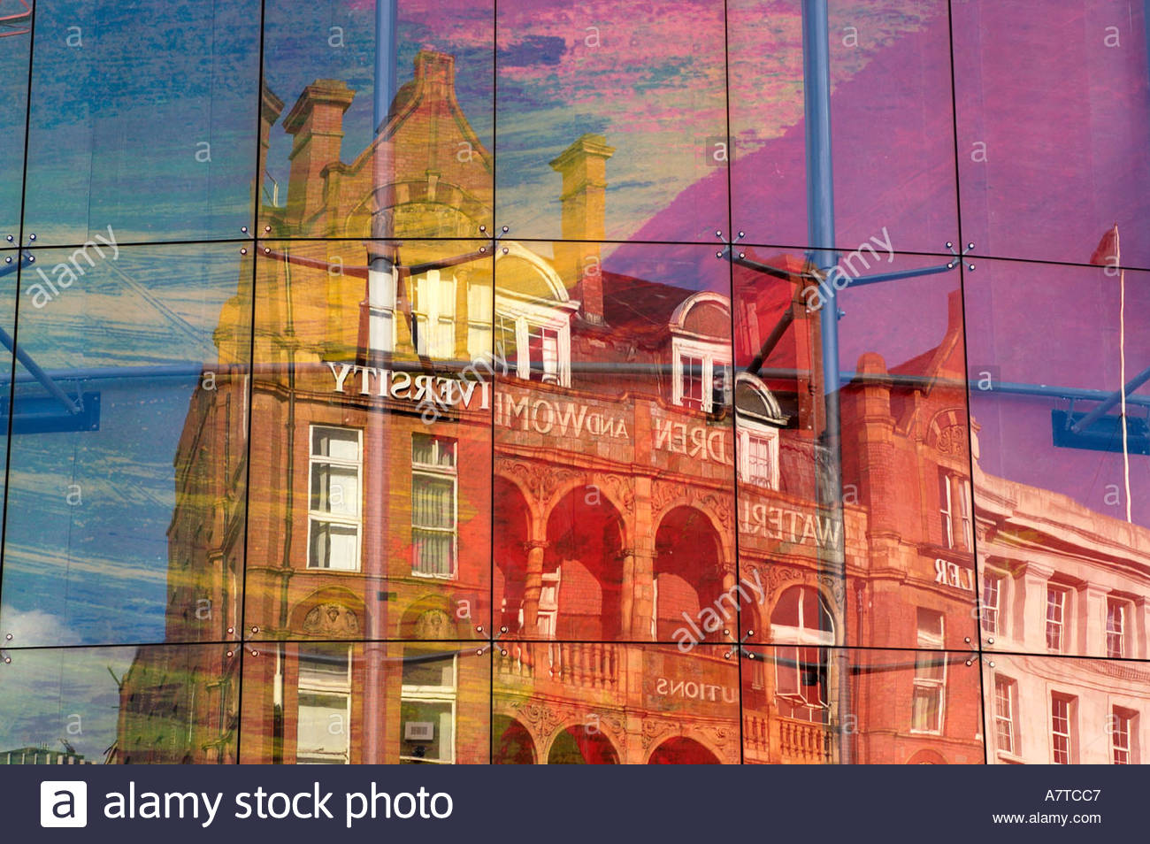 The Royal Waterloo hospital for Children and Women and the Schiller Universtiy building reflected in the curved glass wall of th - Stock Image