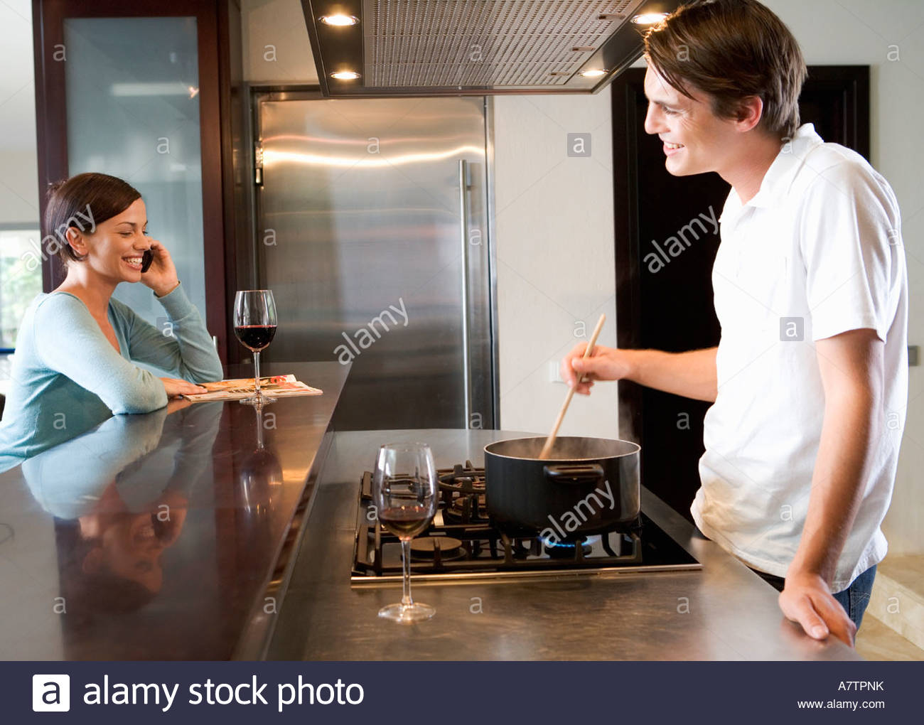 A young couple at home - Stock Image