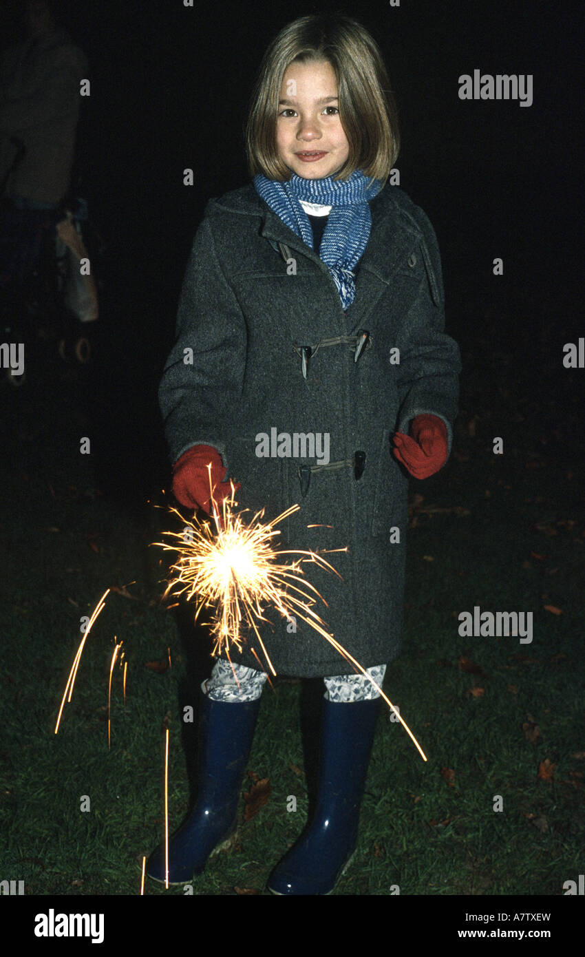 Child celebrating Guy Fawkes playing with sparklers - Stock Image